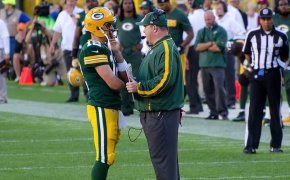 Aaron Rodgers and Mike McCarthy of the Green Bay Packers talking during a timeout