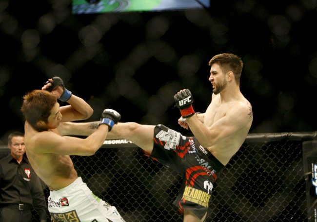 02 July 2011: Carlos Condit (black trunks) lands a kick against Dong Hyun Kim (white trunks) during UFC 132 at the MGM Grand Garden Arena in Las Vegas, Nevada. Condit would win by TKO of the first round.