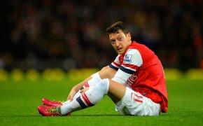 Mesut Ozil ties his boots.
