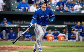 Josh Donaldson runs to first base after connecting with a pitch.
