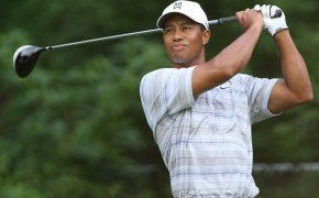 Tiger Woods admires his shot.