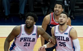 Joel Embiid and Ben Simmons box out Otto Porter Jr.