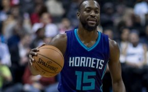 Kemba Walker brings the ball up the court