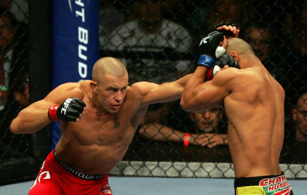 Georges St-Pierre punches Thiago Alves