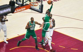 Jaylen Brown of the Celtics dunking against the Cavaliers