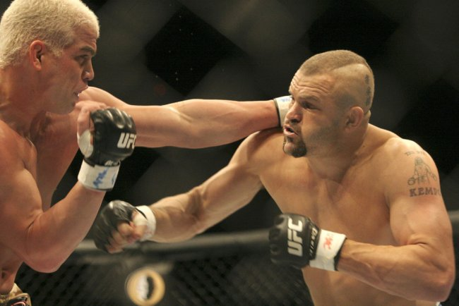 Dec 30, 2006; Las Vegas, NV, USA; TITO ORTIZ (L) battles Light Heavyweight Champion CHUCK LIDDELL