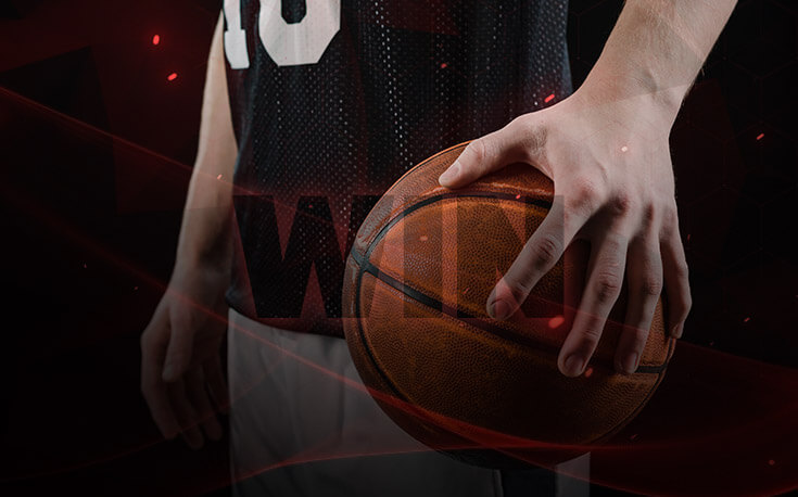 7 attributes of march madness winners man holding basketball