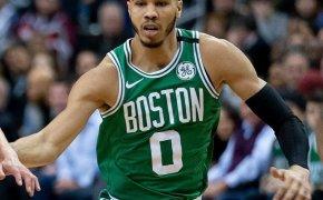 Jayson Tatum of the Boston Celtics running back on defense