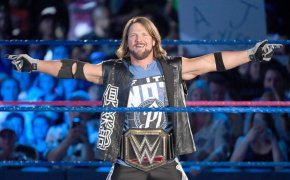 AJ Styles poses in the ring.