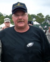 LEHIGH, Pa.,- Andy Reid, Philadelphia Eagles' coach, takes a moment to pose with Senior Master Sgt. James Mcgarvey, 512th Security Forces Squadron operations manager, after the Eagles' training camp, Aug. 3. Sergeant Mcgarvey was one of three reservists from Dover Air Force base, Del. to attend the training camp, which showed the Eagles' players and staff members' appreciation military members and their service. (U.S. Air Force photo/Senior Airman Moses Ross)