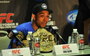 ose Aldo talking to the media during UFC 136