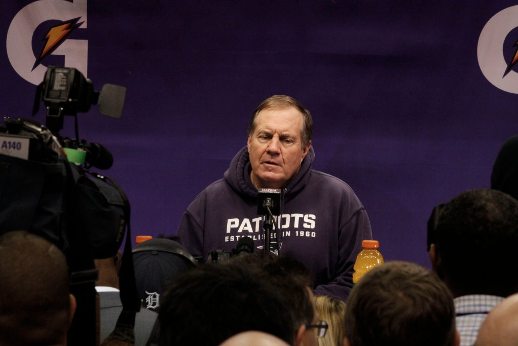 Bill Belichick answering questions at the podium