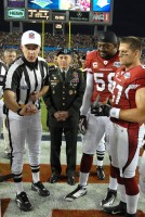 U.S. Army General David H. Petraeus, Commander, United States Central Command, readys to toss the coin at Super Bowl XLIII here Feb 1, at Raymond James Stadium in Tampa, Fla. (USAF Photo By SSgt Bradley Lail) (released)