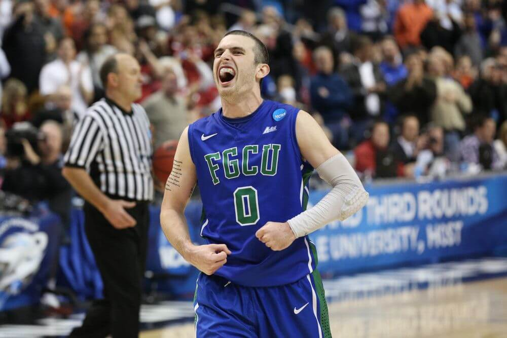 Brett Comer of the FGCU Eagles celebrates during the 2013 NCAA Tournament
