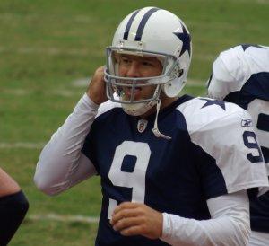 Romo straps up his helmet.