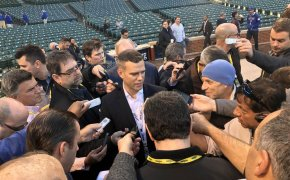 Theo Epstein talks to reporters at Wrigley Field.