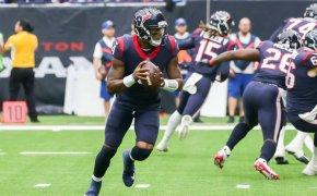 Deshaun Watson of the Houston Texans rolling out to throw