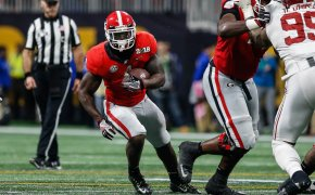 Sony Michel of the Georgia Bulldogs running with the ball
