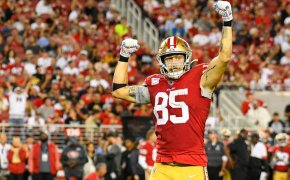 49ers tight end George Kittle flexing