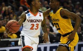 UMBC's Arkel Lamar guards Virginia's Nigel Johnson