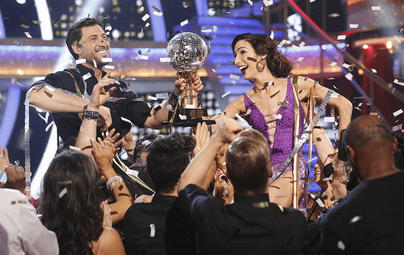 Maksim Chmerkovskiy and Meryl Davis with the Mirrorball trophy.