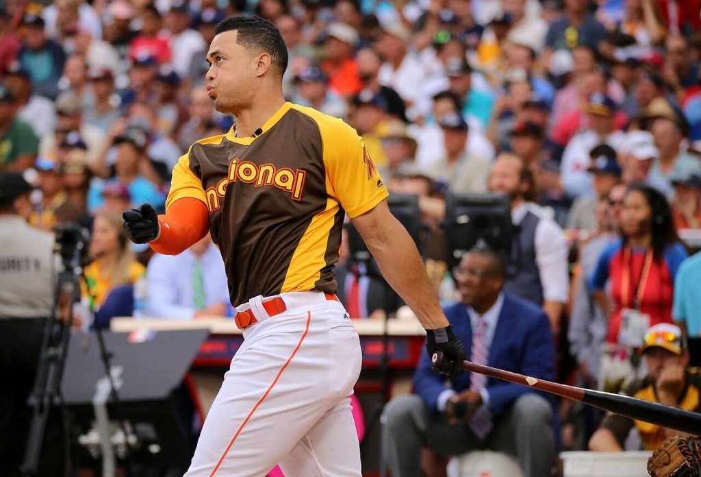 Giancarlo Stanton bats during the home run derby