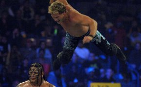 Chris Jericho flying off the top rope.