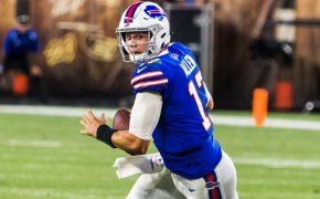 Josh Allen rolling out to pass