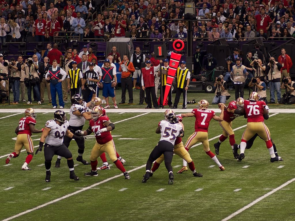 Kaepernick throwing a pass in the Super Bowl
