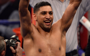 Amir Khan celebrates in the ring.