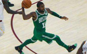 Kyrie Irving of the Boston Celtics making a pass.