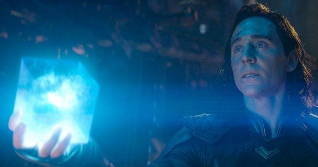 Loki is seen in the Infinity War trailer handing Thanos the Tesseract.