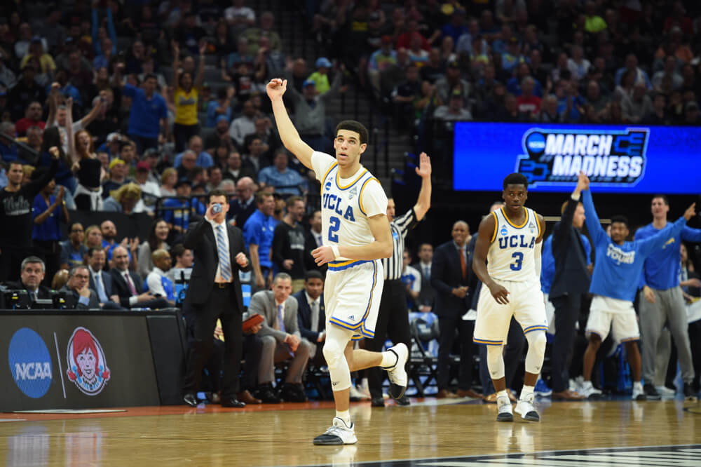 UCLA guard Lonzo Ball celebrates after making a three-point shot
