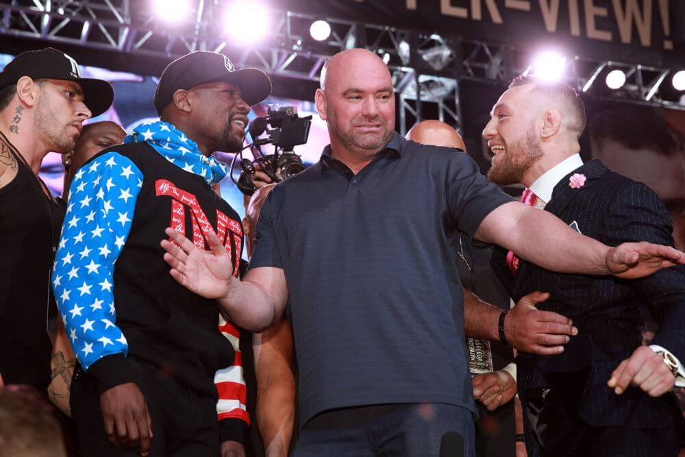 Floyd Mayweather and Conor McGregor separated by Dana White at a press conference