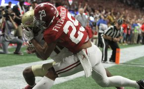 Minkah Fitzpatrick tackles a Florida State receiver