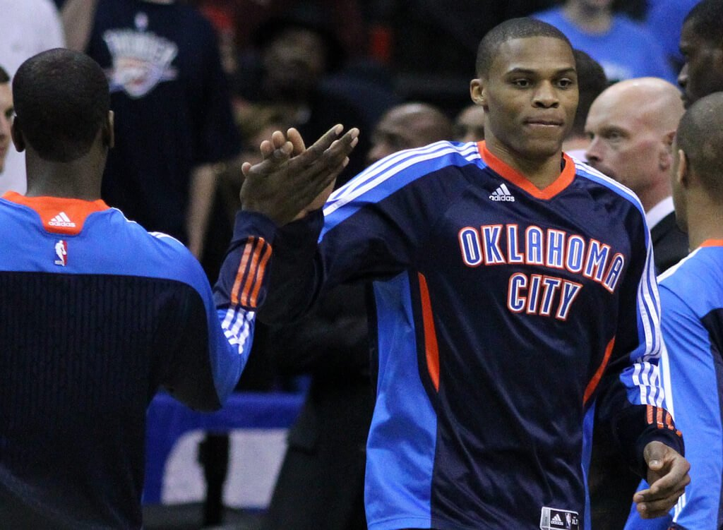 OKC Thunder guard Russell Westbrook giving a teammate a high-five