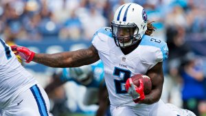 Titans RB Derrick Henry carries the ball