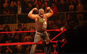 Rey Mysterio flexing on the top rope