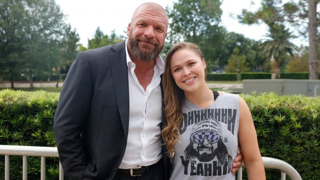 Ronda Rousey and HHH meet at Mae Young Classic.