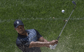 Tiger Woods chipping out of a bunker