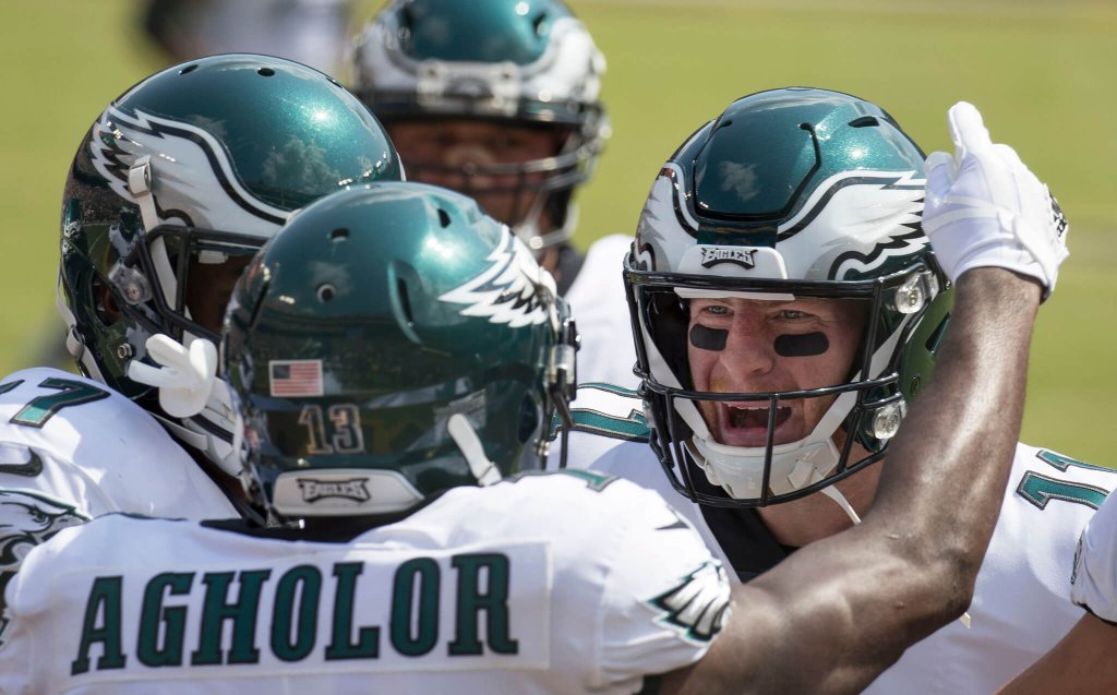 Carson Wentz and Nelson Agholar celebrating a touchdown