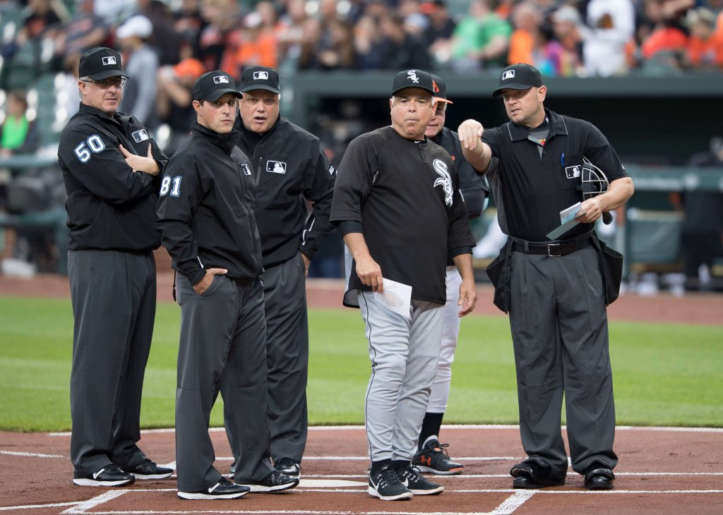 White Sox manager Rick Renteria talks with the umpires
