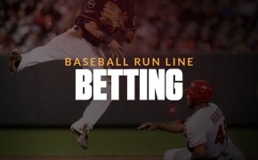 Baseball run line betting text overlay on a baseball player jumping over another player sliding