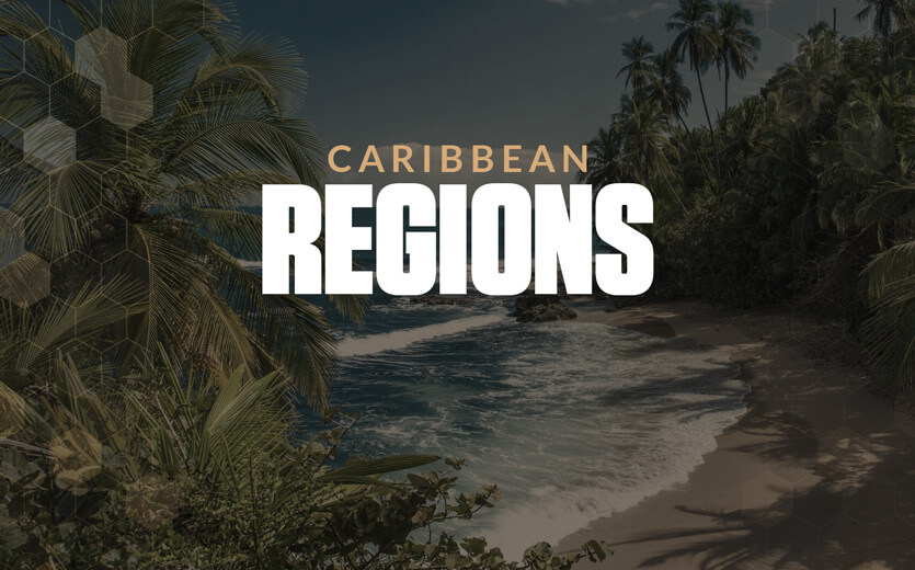 Caribbean regions text overlay on picturesque beach