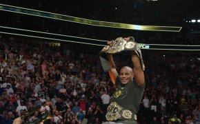 Daniel Cormier celebrates as the light heavyweight and heavyweight double champ
