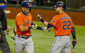 Carlos Correa and Josh Reddick celebrating a home run