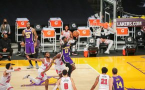 Los Angeles Lakers player Dennis Schroder going up for a layup during a NBA game versus the Chicago Bulls.