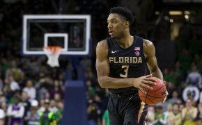 Florida State's Trent Forrest handling the ball on the court during a game.