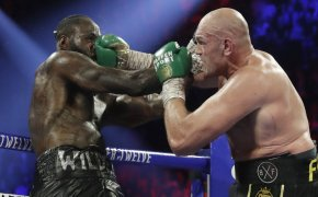 Tyson Fury landing a punch on Deontay Wilder