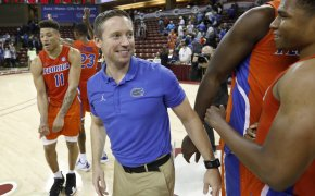 Florida head coach Mike White celebrating on the court.